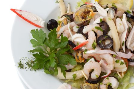 prepared shrimp and mussel salad with olives, lemon and parsley photo