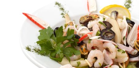 prepared shrimp: prepared shrimp and mussel salad with olives, lemon and parsley Stock Photo