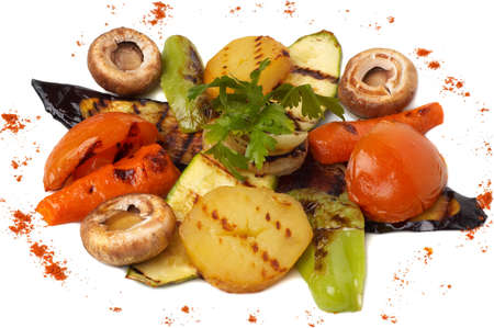 closeup of assorted grilled vegetables, isolated on white, selective focus