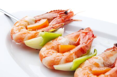large juicy boiled shrimps served on skewer on plate Stok Fotoğraf