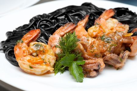 tinted: fried shrimps with exotic black spaghetti tinted by cuttlefish ink