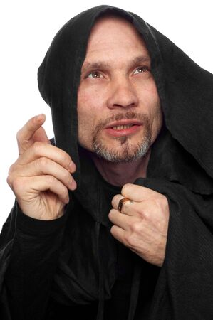 monk or maybe sorcerer in black clothing with hood photo