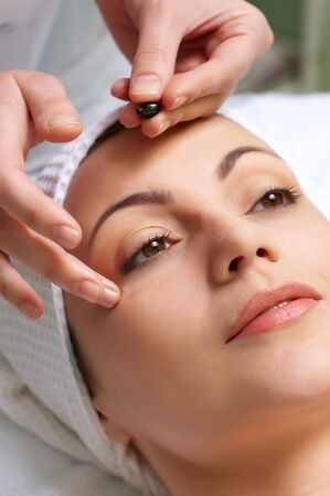applying of vitamin treatment for facial skin in the beauty salon Stock Photo