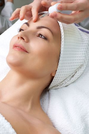 young pretty woman getting special skin treatment at beauty salon  Stock Photo - 2656354