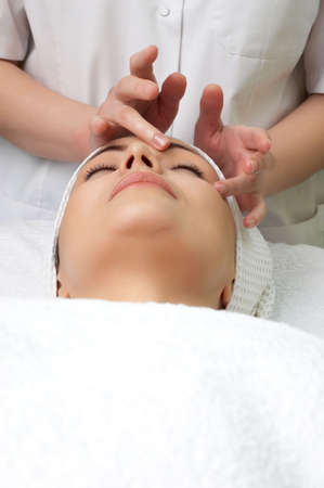 applying facial massage. lot of copyspace. Stock Photo - 2656348