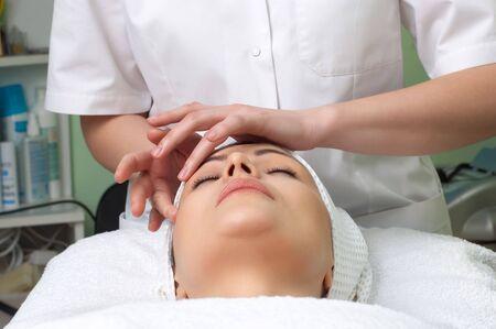 applying facial massage in the beauty salon Stock Photo - 2656351