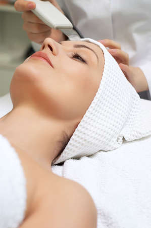 woman getting ultrasound skin cleaning at beauty salon Stock Photo - 2691278