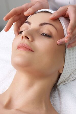 pretty woman getting facial massage in the beauty salon Stock Photo - 2691279