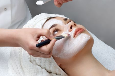 skincare facial: beauty salon series. facial mask applying