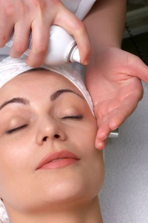 woman getting extra hydratation procedure before skin cleaning at beauty salon Stock Photo - 2836229