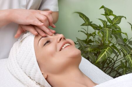 pretty woman getting facial massage in the beauty salon Stock Photo - 2855930