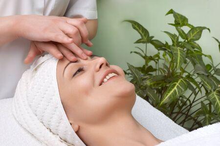pretty woman getting facial massage in the beauty salon Stock Photo - 2855930