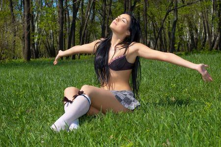 sexy brunette getting getting spring sunbath, sitting on the green grass Stock Photo - 2870424