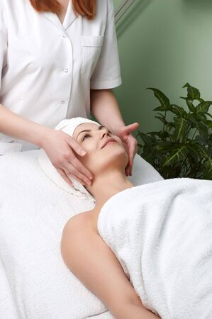 pretty woman getting facial massage in the beauty salon Stock Photo - 2920320