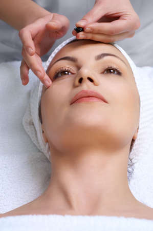 applying of vitamin capsule treatment for facial skin in the beauty salon