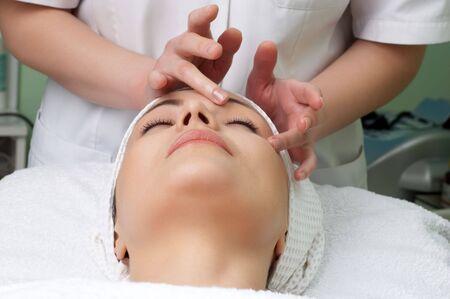 applying facial massage in the beauty salon Stock Photo - 2933546