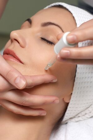 young pretty woman getting special skin treatment at beauty salon
