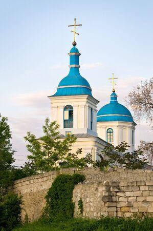 moldova: Orthodox christian church behind the wall, in Chisinau, Moldova, at sunset.