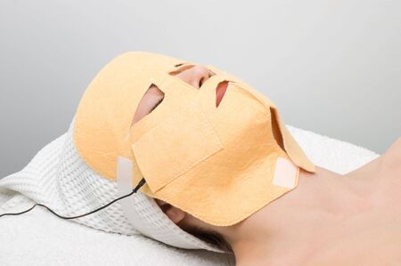 beauty salon, body care series. facial mask electrophoresis procedure applying Stock Photo - 3076463