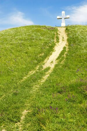 path to the cross on the green hill
