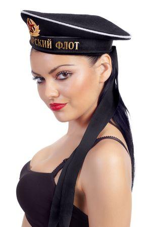 Seductive brunette wearing Russian sailor's cap.