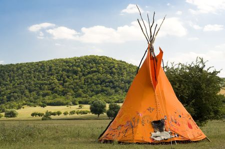 indian ethnic domicile, teepee AKA wigwam on the meadow photo
