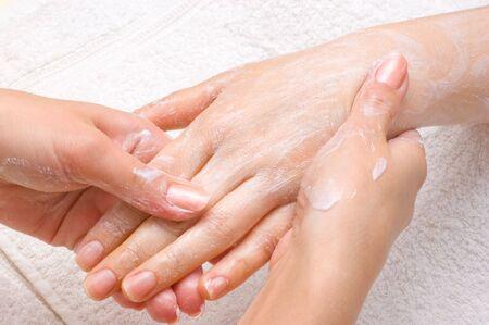 manicure hand: applying peeling scrub or moisturizing cream onto the hands Stock Photo