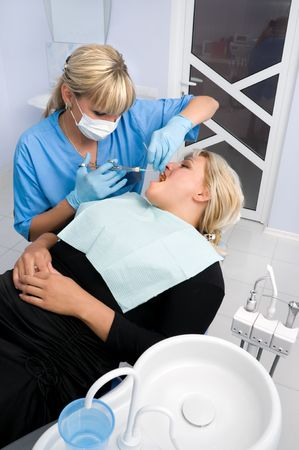 female dentist works with patient the office Stock Photo - 3590202