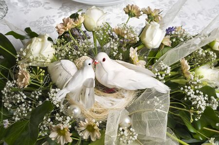 wedding decoration bouquet with two white doves photo