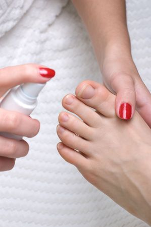 pedicure: peducure, using special spray for skin moisturizing  Stock Photo