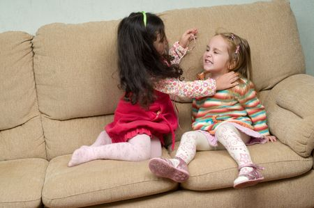 conflicting: two little girls conflicting and trying to fight