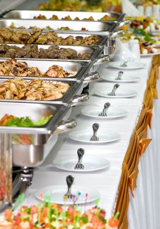 party tray: metallic banquet meal trays served on tables Stock Photo