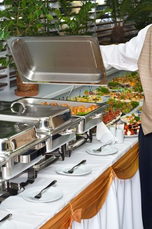 chafing dish: chafing dish heater filled with ready food inside