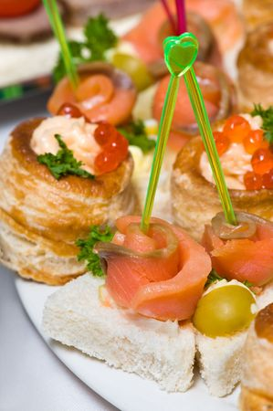 delicious seafood canapes with salmon and red caviar photo