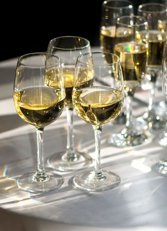 aligote: glasses of white wine illuminated by sunrays Stock Photo