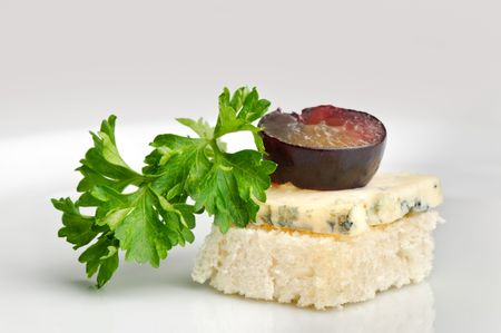 roquefort: canape with Roquefort cheese and grape berry