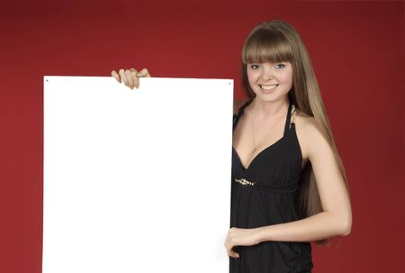 young and pretty blond girl with advertising sheet in her hands photo