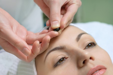 applying of vitamin treatment for facial skin in the beauty salon Stock Photo - 4145836