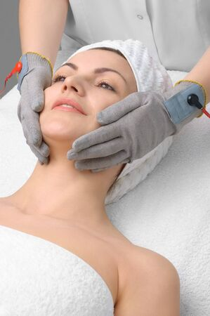 special electric facial massage in the beauty salon Stock Photo - 4175366
