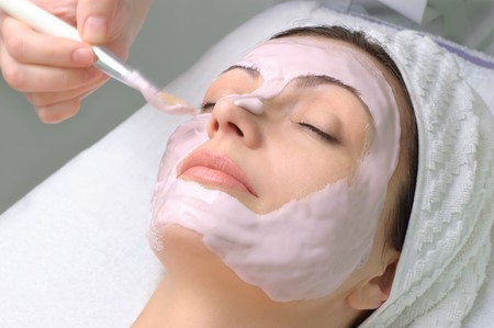 beauty salon series. applying of cleaning facial mask Stock Photo