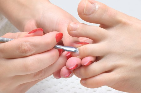 body care series. pedicure applying - toe nails cleaning and moisturizing with special solution. Stock Photo - 4225902
