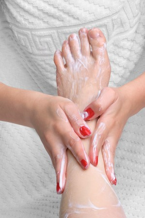 manicure and pedicure: pedicure. feet massage with moisturizing or peeling cream. Stock Photo