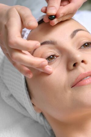 applying of vitamin treatment for facial skin in the beauty salon photo