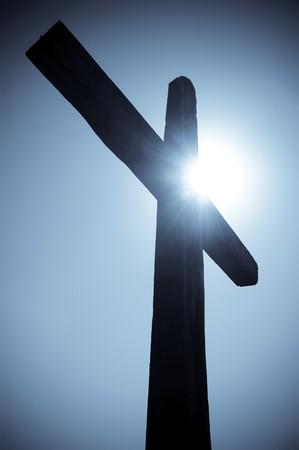 golgotha: silhouette of the Christian cross against the sun
