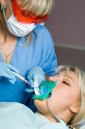 laser surgery: dentistry, tooth cavity filling using special polymer with ultraviolet hardening