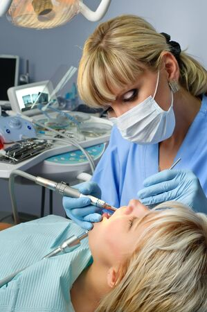 dentistry, doctor and patient, drilling the tooth photo