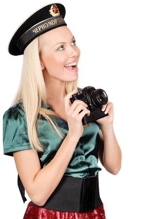 cute blond wearing black soviet military sailor cap and holding SLR camera photo