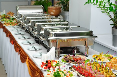 chafing dish: banquet table with chafing dish heaters and canapes