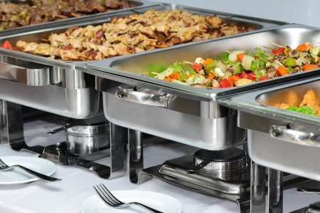 banquet table with chafing dish heaters photo