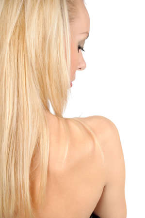 shoulder of a beautiful blond girl , rear view photo